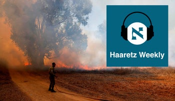 An Israeli soldier battles a blaze in a field close to the southern Israeli kibbutz of Nir Am near the border with the Gaza Strip on August 23, 2020, after it was set off by incendiary kites flown from the Palestinian enclave.