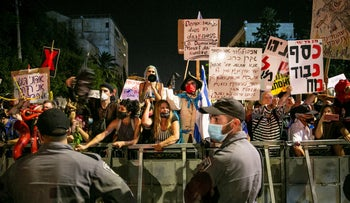Israelis protest against Prime Minister Benjamin Netanyahu and the Government's handling of the coronavirus pandemic, August 18, 2020.