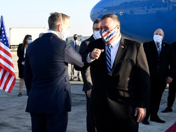 U.S. Secretary of State Mike Pompeo meets the Chargé D'Affaires Jonathan Shrier after landing in Ben Gurion airport in Israel, August 24, 2020