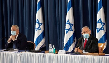 Benny Gantz and Benjamin Netanyahu attend a weekly cabinet meeting at the Foreign Ministry in Jerusalem, June 14, 2020.