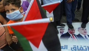 Palestinian refugees tread on images of Crown Prince Mohammed bin Zayed, Donald Trump and Benjamin Netanyahu protesting the Israel-UAE deal. Bass camp, Tyre, Lebanon, August 15, 2020.