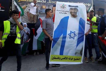 A picture showing Abu Dhabi Crown Prince Mohammed bin Zayed wearing a Star of David gown at a protest against normalizing relations with Israel. Turmus Ayya, near Ramallah. August 19, 2020