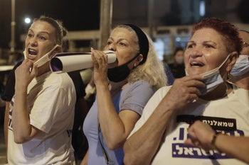 Pro-Netanyahu supporters shouting abuse at protesters after the demonstration in Jerusalem, August 22, 2020.