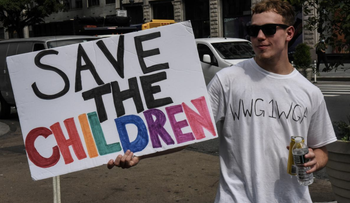 A person wears a t-shirt with the anagram WWG1WGA, the QAnon slogan, while participating in a 'save the children' march and rally in New York City, New York, August 12, 2020.