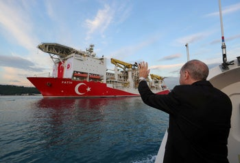 Turkish President Tayyip Erdogan waves as Turkey's drilling vessel Fatih departs for the Black Sea during a ceremony in Istanbul, Turkey May 29, 2020