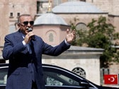 Turkish President Tayyip Erdogan talks to the media after attending Friday prayers at Istanbul's Hagia Sophia, converted back into a mosque from a museum. Turkey, August 7, 2020