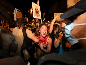 Anti-government protesters march in Jerusalem, August 22, 2020.
