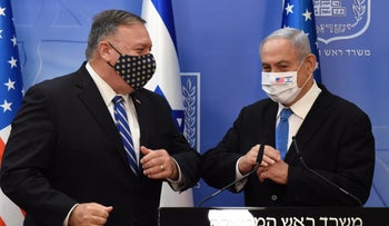 U.S. Secretary of State Mike Pompeo and  Prime Minister Benjamin Netanyahu wearing face masks bump elbows after a joint news conference in Jerusalem, August 24, 2020.