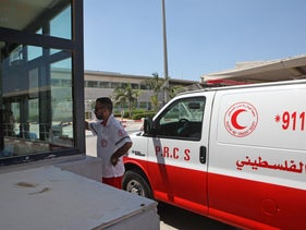 A Red Crescent ambulance carrying a Palestinian patient who had been treated in Israel back to the Gaza Strip, at the Erez border crossing, August 19, 2018.
