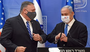 U.S. Secretary of State Mike Pompeo, left, and Prime Minister Benjamin Netanyahu bumping elbows in Jerusalem on Monday.