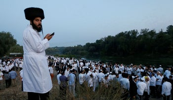 Hasidic pilgrims pray on a bank of a lake near the tomb of Rabbi Nachman during the celebration of the Rosh Hashanah holiday in Uman, Ukraine, September 21, 2017.