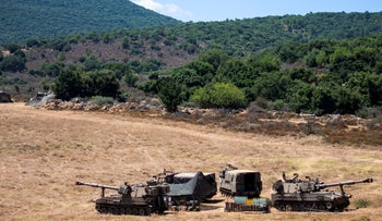 Israeli soldiers sit in a tent next to their mobile artillery piece near the border with Lebanon, northern Israel, Wednesday, August 26, 2020.
