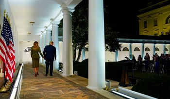 First lady Melania Trump and President Donald Trump walk along the Colonnade after she spoke on the second night of the Republican National Convention from the Rose Garden of the White House, Tuesday, Aug. 25, 2020, in Washington