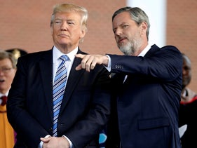 President Donald Trump stands with Liberty University President Jerry Falwell Jr. in Lynchburg, Va., August 25, 2020.