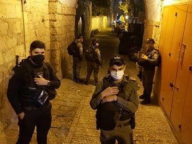 Israeli police officers stand in the alley through which Eyad Hallaq fled in Jerusalem's Old City, August 26, 2020