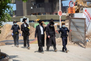 Members of Atra Kadisha, an ultra-Orthodox organization that works to protect graves, at the site, August 26, 2020.