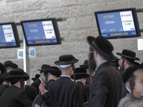 Hasidic Jews await check-in for a flight to Ukraine on the way to Uman, Ben Gurion airport, September 13, 2019.