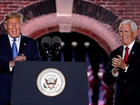 President Donald Trump and Vice President Mike Pence stand on stage on the third day of the Republican National Convention at Fort McHenry National Monument and Historic Shrine in Baltimore, Wednesday, Aug. 26, 2020