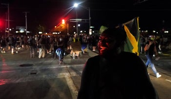 Protesters march against the police shooting of Jacob Blake in Kenosha, Wisconsin, August 26, 2020. ]