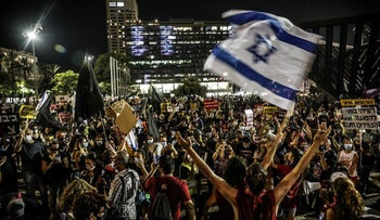 Hundreds of Israelis gather at Tel Aviv's Rabin Square ahead of a protest march calling for the resignation of Prime Minister Benjamin Netanyahu, August 27, 2020