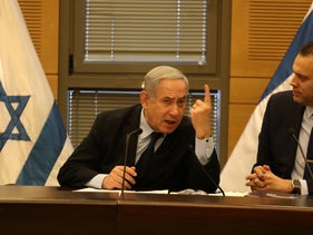 Netanyahu with his loyalist coalition chairman Miki Zohar, February 2020.