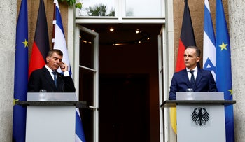 German Foreign Minister Heiko Maas (R) and Israeli Foreign Minister Gabi Ashkenazi attend a news conference in Berlin, Germany, August 27, 2020.
