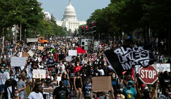 People walk on Pennsylvania Avenue during the March on Washington, August 28, 2020.
