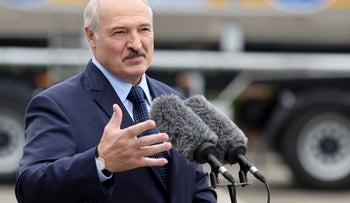 Belarusian President Alexander Lukashenko gestures while addressing employees of the Orsha dairy plant in Orsha, Belarus, Friday, August 28, 2020.