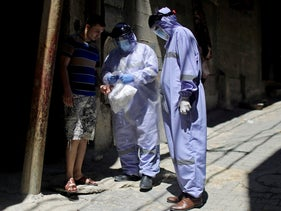 UN workers hand out medicine to a Palestinian man, Gaza City August 27, 2020.