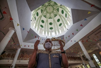 A Palestinian man prays alone in an empty mosque in Rafah, Gaza, August 28, 2020.