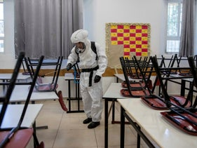 Disinfecting a class room in Jerusalem in June
