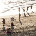 Beachgoers in Tel Aviv playing games as the heat wave continues, August 2020.