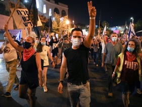 Anti-Netanyahu protesters march in Jerusalem on August 29, 2020.