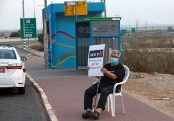 "Moshe Kuperman from Kibbutz Erez at the weekly protest against Prime Minister Netanyahu outside Sderot. ""I feel that I need to do this."""