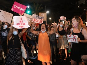 Demonstrators protest the government in Tel Aviv following the suspected Eilat gang rape, August 20, 2020.