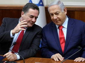 Prime Minister Benjamin Netanyahu, right, listens to then-Transportation Minister Yisrael Katz during the weekly cabinet meeting in Jerusalem, May 12, 2019.