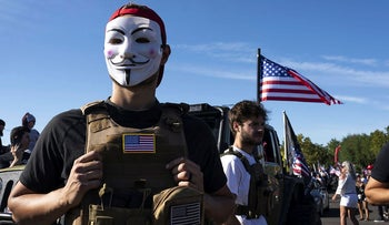 A man who identified himself only as Jonathan wears a Guy Fawkes mask during a rally in support of President Trump on August 29, 2020 in Clackamas, Oregon