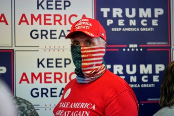A supporter with a patriotic face mask attending the opening of the Nebraska Trump Victory Office in Omaha, Nebraska, August 20, 2020.