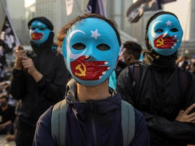 Protesters at a rally in solidarity with the Uighur minority in China which was later broken up by Hong Kong riot police. December 22, 2019.