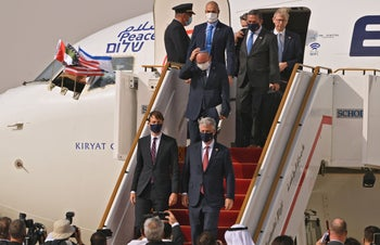 Members of the U.S. and Israeli delegations disembark upon landing on the tarmac in Abu Dhabi on August 31, 2020.