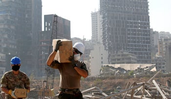 A member of the French military works at the damaged site of the massive August 4, blast in Beirut's port area, in Beirut on August 31, 2020.