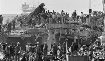 Rescuers continue to probe the wreckage of the U.S. Marine barracks a day after a suicide truck bomb near Beirut airport, Lebanon, October 24,1983.