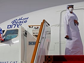 An Emirati official prepares to open the door of the El Al airliner carrying a U.S.-Israeli delegation to the UAE, August 31, 2020.