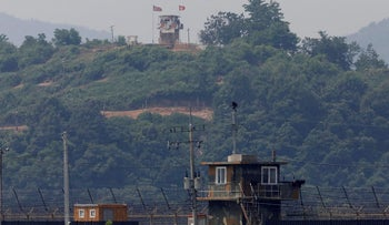 A North Korean soldier stands guard at his guard post inside North Korean territory, in this picture taken from Paju, South Korea, near the demilitarized zone (DMZ) separating the two Koreas, June 17, 2020