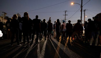 Protesters clash with deputies of the Los Angeles Sheriff's Department during protests following the death of Dijon Kizzee on Monday, Aug. 31, 2020, in Los Angeles, Calif. (AP Photo/Christian Monterrosa