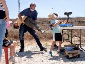 Israelis at a paintball attraction in the settlement of Kedumim in the West Bank, August 2020.