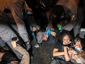 Protesters lying on the ground as police attempt to clear them out, Jerusalem, August 29, 2020