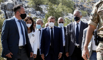 French President Emmanuel Macron attends a ceremony to plant a cedar with members of the NGO Jouzour Loubnan in Jaj, near Beirut, Lebanon, September 1, 2020.
