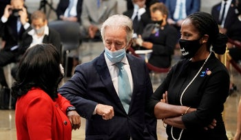 Rep. Richard Neal with Rep. Terri Sewell, left, and Rep. Stacey Plaskett, talking prior to the start of a ceremony for the late Rep. John Lewis, July 27, 2020 at the Capitol in Washington.