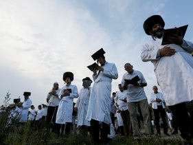 Ultra-Orthodox Hasidic Jewish pilgrims pray on a bank of a lake near the tomb of Rabbi Nachman of Breslov during the celebration of the Rosh Hashanah holiday, in Uman, Ukraine, September 21, 2017.